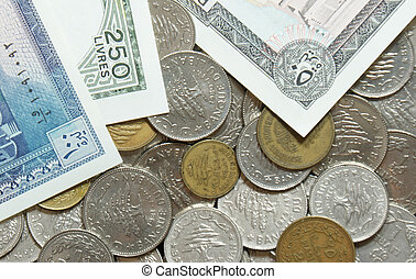 Outdated Lebanese coins and paper bills - A collection of...