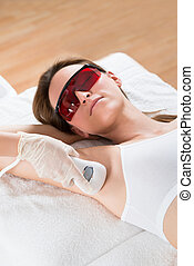 Beautician Removing Hair Of Woman With Epilator - Beautician...