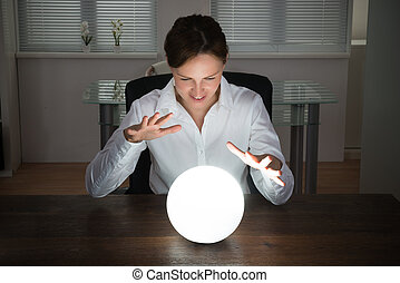 Businesswoman Looking In A Crystal Ball - Young...