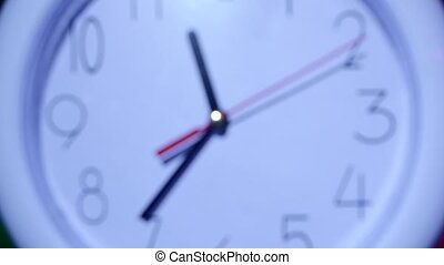 white clock on colorful background. slow motion - close up...
