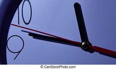 Photo of clock showing several minutes to noon, night. slow...