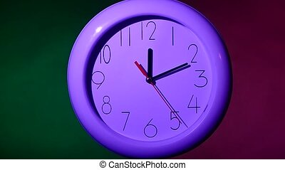 office clock on black background, night Slow motion - close...