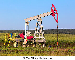 pump swinging oil in the field outdoors