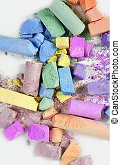 Colorful chalk broken colors mess over white