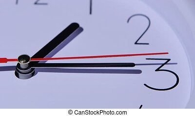 Close-up office clock, dial of hours, slow motion