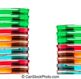 Stack of colorful Petri dishes isolated