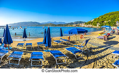 Typical vacation beach with beachchairs and sunshades at...