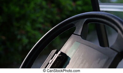 Black steering wheel in a golf car - Close up of a black...
