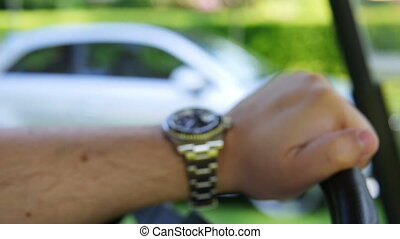 Close up of a males arm wearing a silver watch