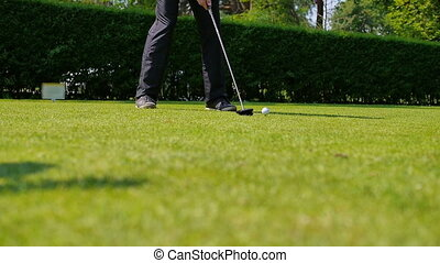 Man playing a drive at the golf course - A man playing a...