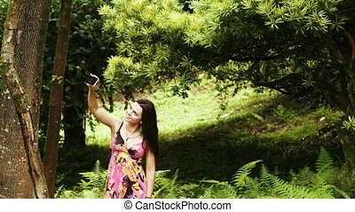 Girl photographing myself in park