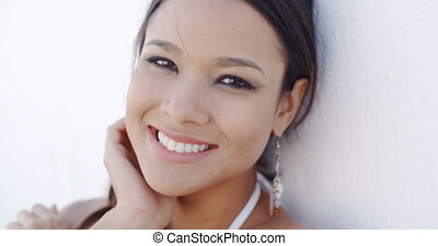 Smiling elegant young woman