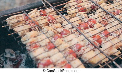Pieces of fish and tomatoes in sesame stir-fried on a grill...