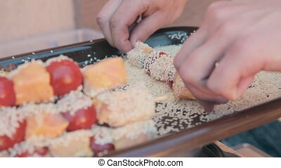 Fish and tomato skewers dipped in sesame for barbecue - Fish...