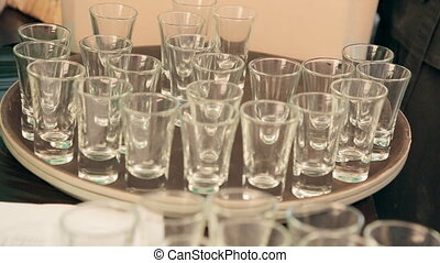 Waiter puts empty glasses on a tray at a banquet - Waiter...