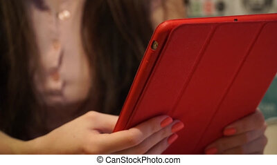girl uses the app in the computer tablet at night