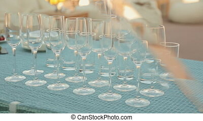 Row of empty wine glasses on a table with snacks on banquet...