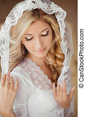 portrait of beautiful bride with makeup wearing in Classic White Veil at morning in wedding day.