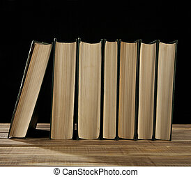 books are isolated on a black background
