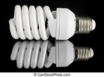 energy efficient light bulb on black background