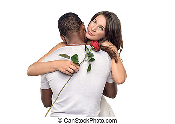 Sentimental young woman hugging her boyfriend or sweetheart...