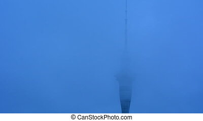 Clouds over Auckland Sky Tower. At 328 metres, the Sky Tower...