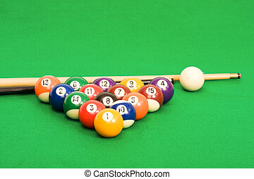 Billiard balls arranged on a green pool table - Billiard...