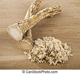 horseradish with on wooden background