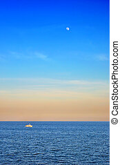 Sea view-wonderful sky with moon over water ripples and...