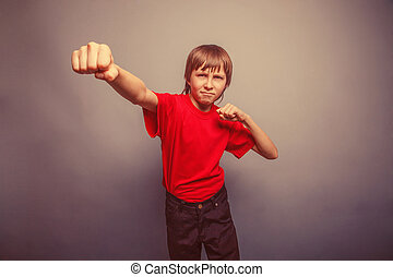 Boy, teenager, twelve years red in shirt, red showing fists...