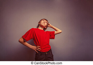 Boy, teenager, twelve years in red shirt, thoughtful, head...