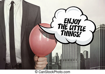 Enjoy the little things text on speech bubble with...