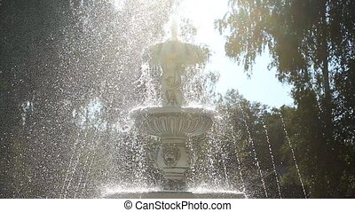 Fountain in sunlight - Water fountain in sunlight summer...