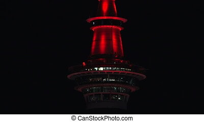 Sky Tower illuminate in Red color.It's currently lit up red...