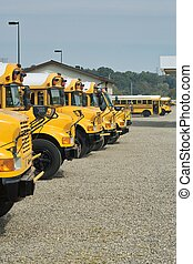 Line of Buses - A line of school buses ready and waiting to...