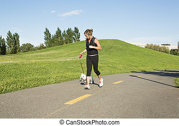 Beautiful young woman jogging with her dog - A Beautiful...