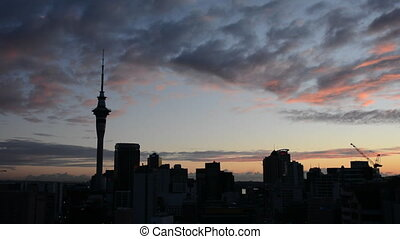 Silhouette of Auckland skyline at sunrise.Auckland is the...