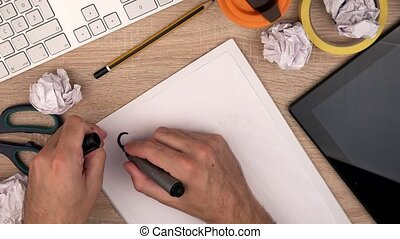 Businessman writing Strategy on piece of paper with felt pen...