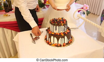 Cutting wedding cake at wedding