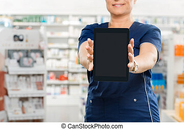 Midsection Of Pharmacist Showing Digital Tablet With Blank Scree