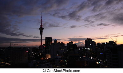 Silhouette of Auckland skyline at sunriseAuckland is the the...