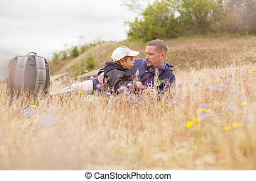 parent talking child nature lying grass meadow field