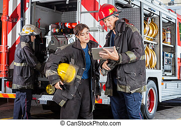 Firefighters Using Tablet Computer - Young and mature...
