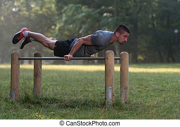 Young Man Workout In The Park - Handsome Muscular Young Man...