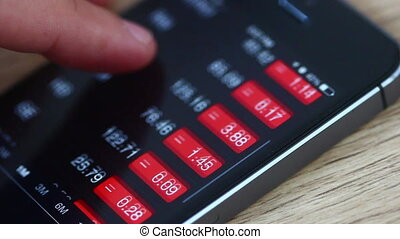 Checking Stock - A person checking stock market data on...
