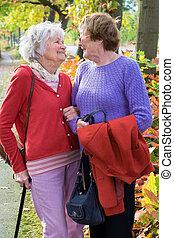 Two Senior Women Smiling to Each Other. - Three Quarter Shot...