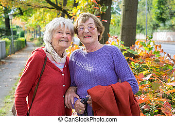 Happy Middle Aged Women in Autumn Outfits. - Half Body Shot...