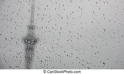 Stormy day sky tower auckland - Rain drops falls on a window...