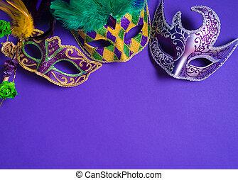 Mardi Gras or carnival mask on purple background - Mardi...