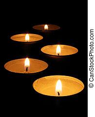 Burning candle isolated on black background...